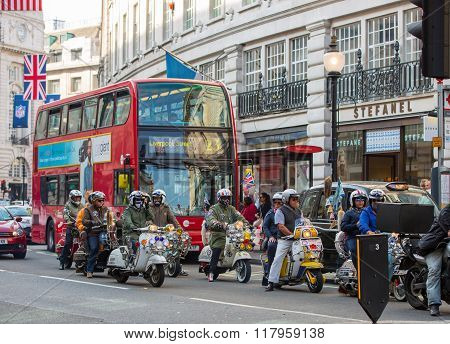Regent street view with transport and walking people. London