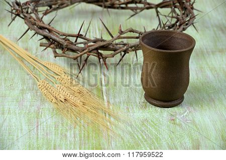 Crown of thorns, cup of wine and wheat o vintage table