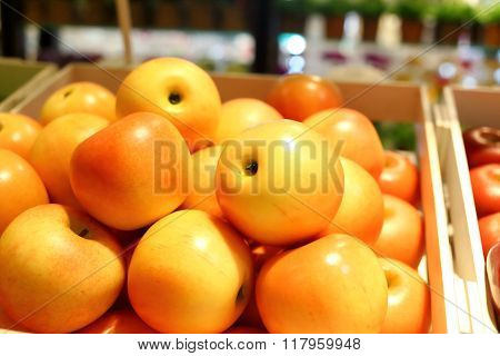 Fake Fruits And Fruits On Shelves