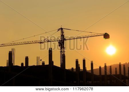 Construction Site With Crane On Sunset