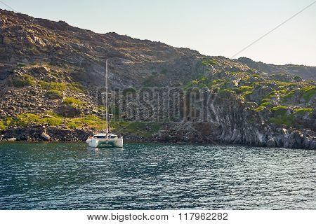 SANTORINI, GREECE - AUGUST 06, 2015: yacht near Santorini sea coast. Santorini, classically Thera, and officially Thira, is an island in the southern Aegean Sea.