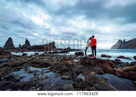 Couple on the rocky coast