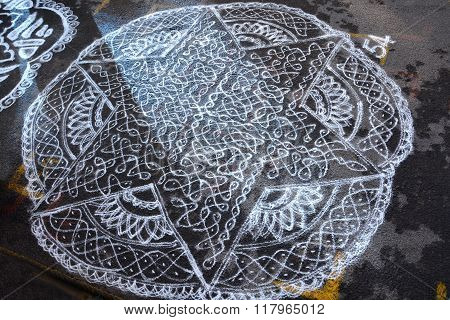 Chennai, India - January 11: Kolam festival as seen in Chennai, India on January 11 2016. Kolam festival conducted in Mylapore Kapleeswarar temple during January month of every year. Kolam is an art of drawing on the streets using rice flour powder.