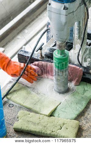 Worker Drilling Floor