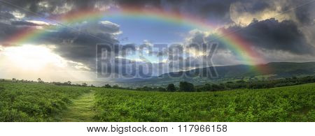 Stunning Summer Sunset Across Countryside Landscape With Dramatic Rainbow