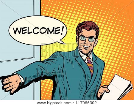 Welcome businessman opens the door