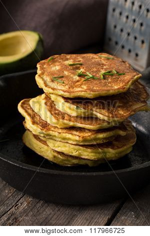 Stack of homemade savory vegetable pancakes / cabbage pancakes / zucchini pancakes / vegetable fritters with cheese. Natural light, selective focus ** Note: Shallow depth of field