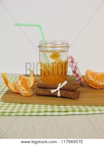 Detox water with mandarin and cinnamon