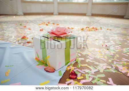 Presentation box on wedding ceremony with ribbons confetti