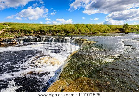A Picturesque Waterfall On The River