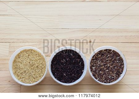 Rice on dark wooden table