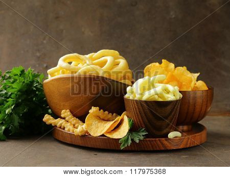 Assorted different kinds of chips - onion rings, sticks and flat