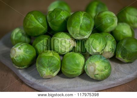 brussels sprouts raw on a wood tablet