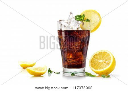Glass Of Cola or Ice Tea With Ice Cubes, Slices Of Lemon And Peppermint Garnish, Isolated On W