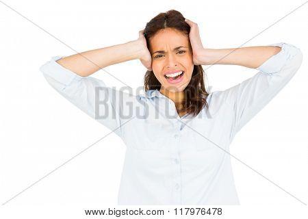 Woman getting a headache against white background