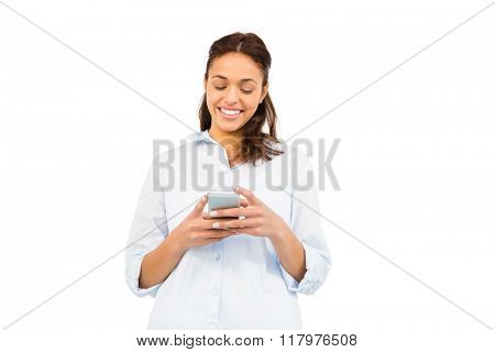 Smiling casual woman text messaging on white background