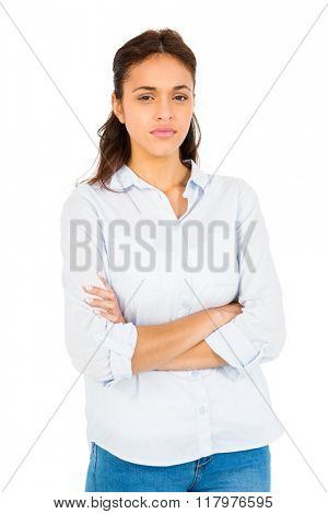 Worried woman with arms crossed on white background