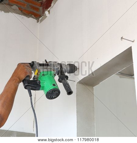 Worker Use Driller For Drill Wall