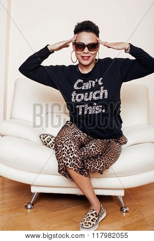 pretty stylish african american big mama woman well dressed. swag relax at home, leopard print on cl