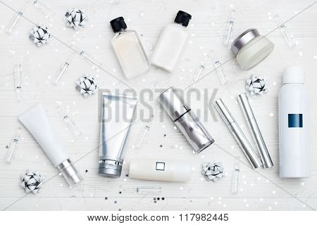 tubes with cosmetics on a beautiful silver festive background