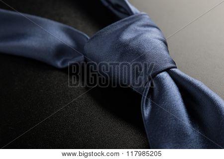 Blue Tie On Black Table