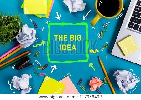 The big idea. Text words advice on office table desk with supplies, white blank note pad, cup, pen,