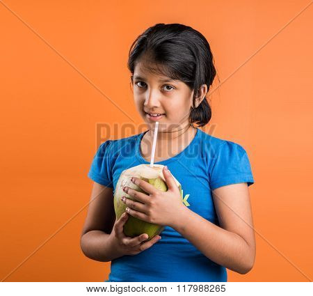 indian small girl drinking coconut water, asian girl with coconut, indian girl holding coconut with