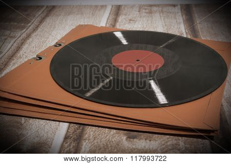 Long playing record in jacket, vintage background