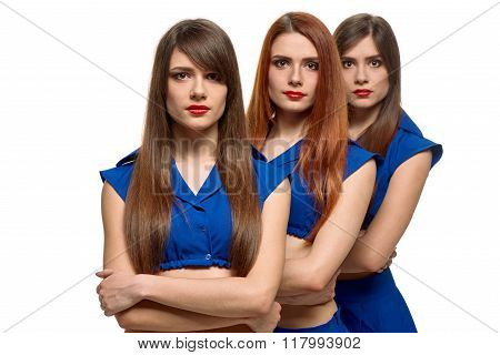 group portrait of three serious women. triplets sisters