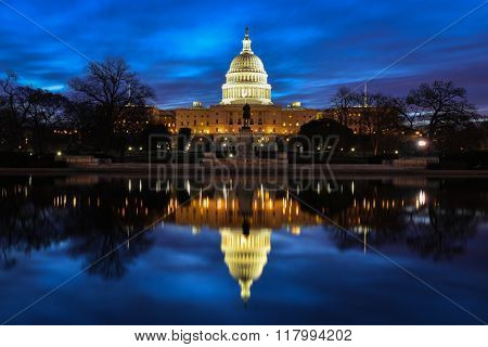 US Capitol Building and reflection at sunrise - Washington DC, USA