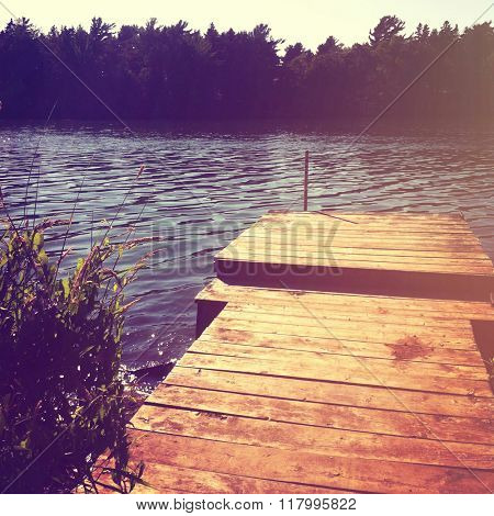 Beautiful view of pond with boat dock