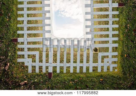 white wooden fence on field with sky in background, bend photo manipulation