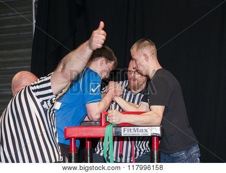 Unidentified Sportsmen Compete In Arm Wrestling