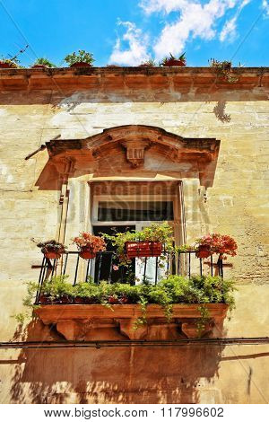 Beautiful vintage balcony with colorful flowers