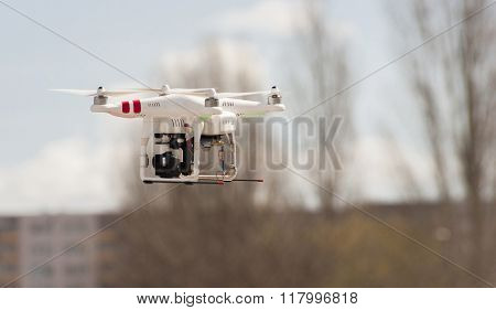 Modern Rc Drone / Quadcopter With Camera Flying On The Sky