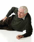 image of fallen  - A vertical image of a senior man on the ground who has injured his hip in a fall - JPG