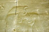 stock photo of horus  - Ancient Egyptian stone carving of the snake headed god Apophis  - JPG