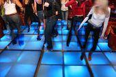 picture of night-club  - people in dance night club 3 on blue floor - JPG