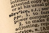 image of pronunciation  - close-up of the word service in a dictionary.