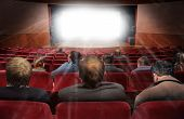 stock photo of movie theater  - spectators in hall of cinema with movie collage - JPG