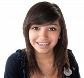 pic of braces  - Cute Hispanic teenage girl smiling with braces on a white background - JPG
