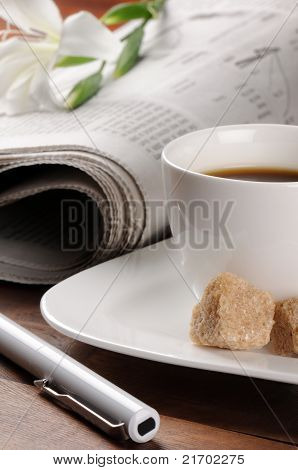 Morning coffee time with newspaper