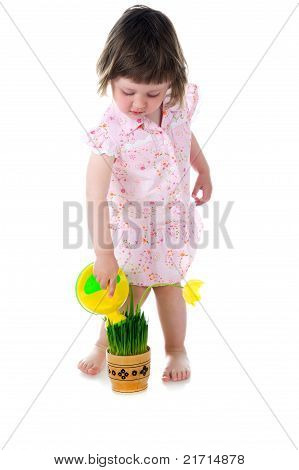 little girl watering