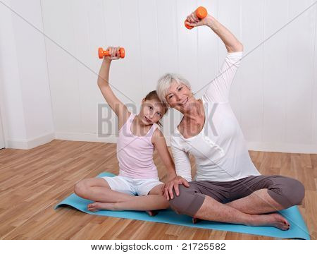 Grandmother and young girl doing fitness exercises