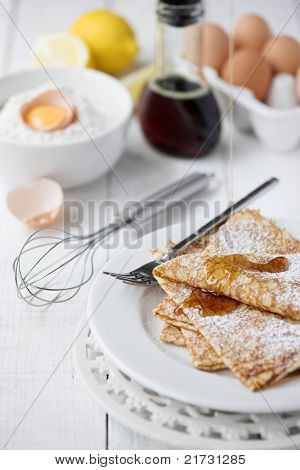 Freshly Prepared Crepes With Maple Syrup