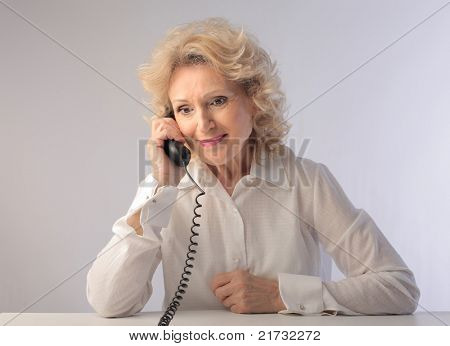 Smiling senior woman talking on the telephone
