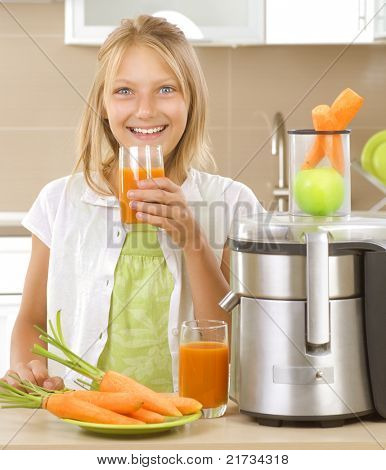 Happy Girl drinking fresh carrot and apple juice. Juice Extractor.Healthy lifestyle