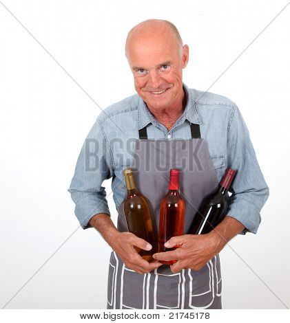 Portrait of senior winemaker holding bottles of wine