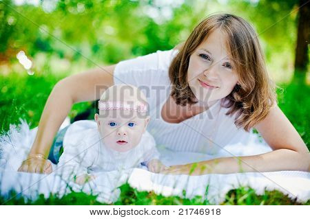 Beautiful Mother With Her Child
