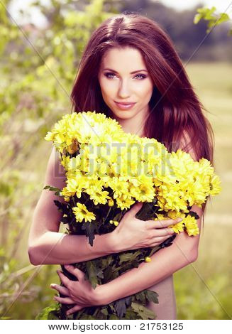 Woman holding yellow flowers . otdoor shoot